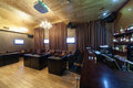 Stylish interior of karaoke bar with leather armchairs and many screens Stock Photos