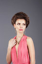 Stylish lady in pink dress with ornamentation pretty Stock Image