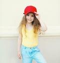 Stylish little cute girl child wearing a cap