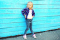 Stylish little girl child in city over colorful blue Royalty Free Stock Photo