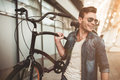 Stylish man with bicycle Royalty Free Stock Photo