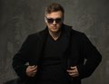 Stylish man in black coat young and sunglasses Royalty Free Stock Photography