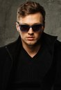 Stylish man in black coat young and sunglasses Stock Photo