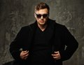 Stylish man in black coat young and sunglasses Stock Photography