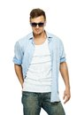 Stylish man in blue shirt and sunglasses jeans wearing isolated on white Royalty Free Stock Photos