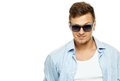 Stylish man in blue shirt and sunglasses wearing isolated on white Royalty Free Stock Images