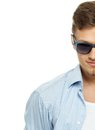 Stylish man in blue shirt wearing sunglasses isolated on white Stock Image