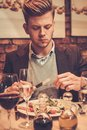 Stylish man eating at restaurant. Royalty Free Stock Photo