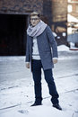 Stylish man in a jacket, sweater, scarf and glasse Royalty Free Stock Photo