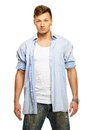 Stylish man in shirt blue and jeans with earring isolated on white Stock Photos