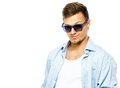 Stylish man in shirt blue wearing sunglasses isolated on white Royalty Free Stock Image