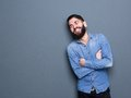 Stylish man smiling with arms crossed close up portrait of a young beard Stock Photography