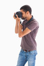 Stylish man taking photograph with digital camera on white background Royalty Free Stock Images