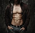 Stylish man wearing hoodie with muscular torso Royalty Free Stock Photos
