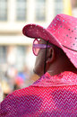 Stylish man wearing pink a costume with glitters and sunglasses Royalty Free Stock Image