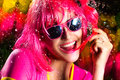 Stylish party girl expressing happiness water splash portrait of beauty with pink wig and glasses Royalty Free Stock Images