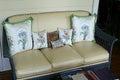 Stylish patio furnishing with cushions furnished sofa and Stock Photos