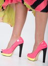 Stylish pink high heels with a green yellow trim partial image of woman s legs and Royalty Free Stock Photo
