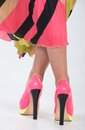 Stylish pink high heels with a green yellow trim partial image of woman s legs and Stock Photography