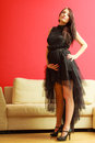 Stylish pregnant woman in black pretty girl evening dress preparing for event glamour look prospective mothering concept Stock Photos