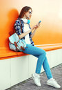 Stylish pretty young woman using the smartphone Royalty Free Stock Photo