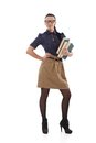 Stylish schoolmistress with books young posing in hand other hand on hip Stock Photography