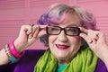 Stylish senior woman wearing prescription glasses with black fra