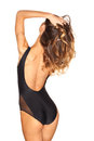 Stylish sexy girl in a black swimsuit isolated on white background Royalty Free Stock Photo