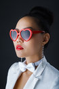 Stylish shades portrait of a young asian woman in heart shaped sunglasses Stock Images