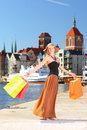 Stylish shopper woman in old town gdansk autumn hat with shopping sale bags european city the background poland europe Royalty Free Stock Photo