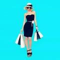Stylish shopping lady with shopping bags on blue background Royalty Free Stock Photo