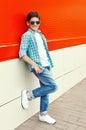 Stylish smiling child boy wearing sunglasses and shirt in city Royalty Free Stock Photo