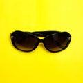 Stylish sunglasses on yellow background. fashion top view flat lay Royalty Free Stock Photo