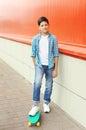 Stylish teenager boy riding on skateboard Royalty Free Stock Photo