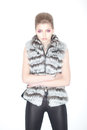 Stylish Trendy Young Woman in Fur Waistcoat and Leggings Posing in Studio Stock Image