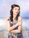 Stylish vogue model in the great outdoors woman posing gorgeous fashion clothing with retro style makeup and brunette hair Royalty Free Stock Photo