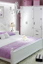 Stylish white bedroom with double bed Royalty Free Stock Photos