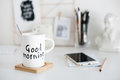 Stylish white desktop, home office interior details with coffee Royalty Free Stock Photo