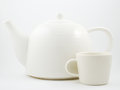 Stylish white porcelain teapot and cup on a light background Stock Image