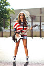 Stylish woman with electric guitar Royalty Free Stock Photo
