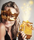 Stylish woman with golden mask and gift Royalty Free Stock Photo