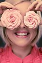 Stylish woman happy blond with two rosebuds Stock Image
