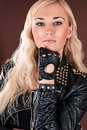 Stylish woman in a leather jacket beautiful Stock Images