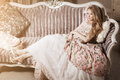 Stylish woman in a luxurious interior vintage dress Royalty Free Stock Photo