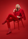 Stylish woman in red suit in studio over background Royalty Free Stock Image