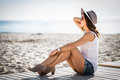 Stylish woman at the summer beach in a hot day Royalty Free Stock Photo