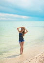 Stylish woman at the summer beach in a hot day. Royalty Free Stock Photo