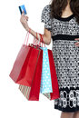 Stylish woman walking with shopping bags and credit card Royalty Free Stock Photo