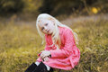 Stylish young girl teen, blonde with deep look Royalty Free Stock Photo