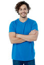 Stylish young guy posing confidently cheerful man with folded arms Royalty Free Stock Photo